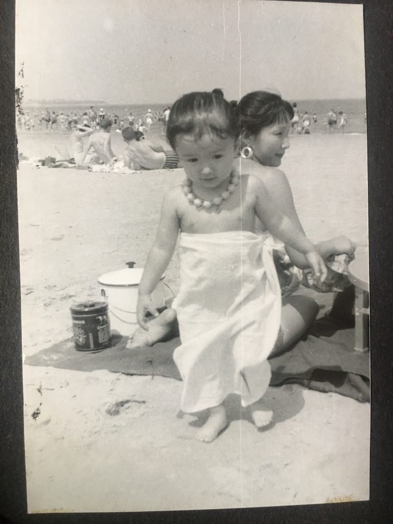 My mother and I at an unknown beach in Japan