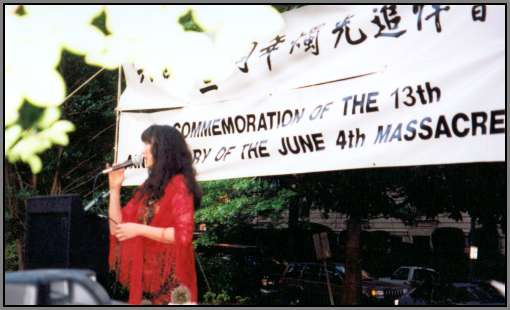 Demian Yumei singing at the Candlelight Vigil for the Students of Tiananmen Square, Washington DC, 2002